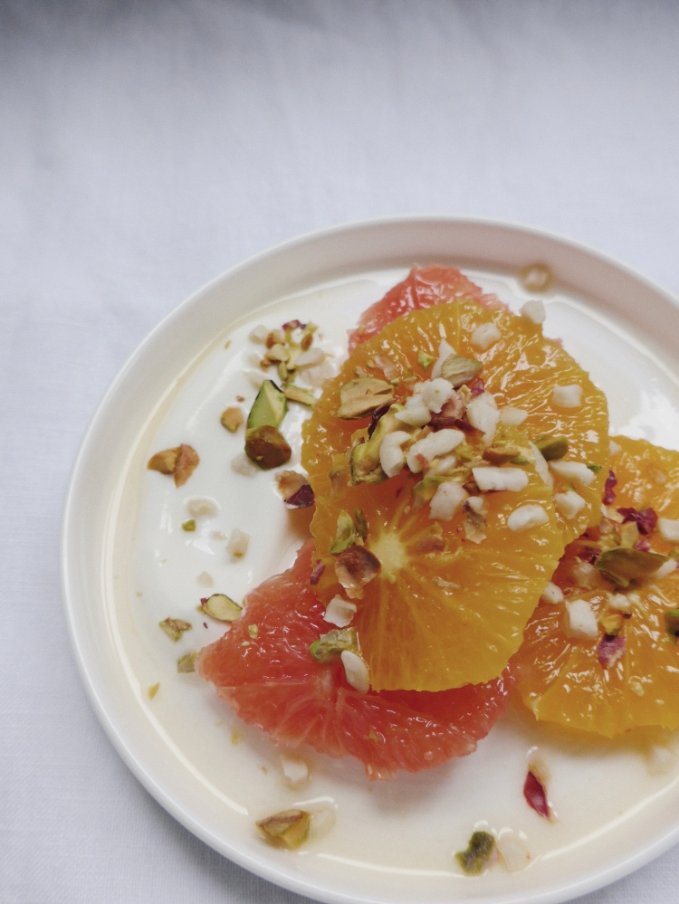 breakfast of oranges, yoghurt, pistachio and hazelnuts on allthatshecraves.com